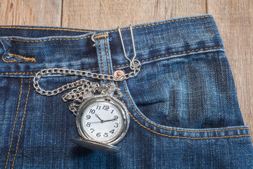 pocket watch in pocket of jeans