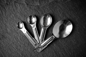 Measuring Spoons on Slate Stone Background