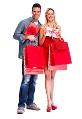 Loving couple with shopping bags.