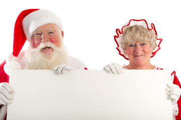 Santa a Mrs Claus hold sign