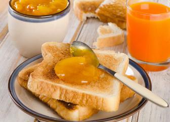 Slices toast bread with fresh orange juice