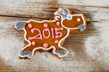 Christmas gingerbread goat on a wooden background