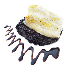 Whitefish with black rice and sauce