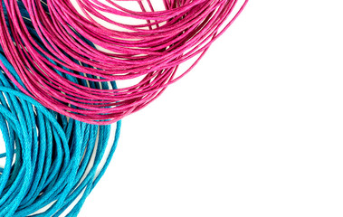 Vibrant blue and pink string rope with white copyspace