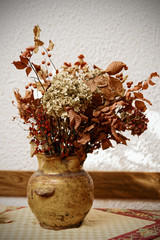 Dried bouquet in pot, toned image