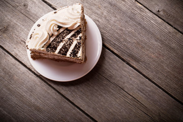 Piece of cake on the wooden table