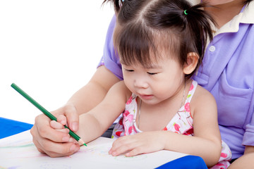 Mother with child girl draw and paint together