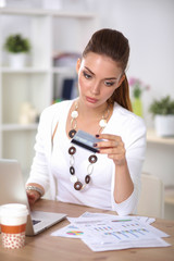 Businesswoman doing online shopping through laptop and credit