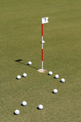 Golf ball on practice green.