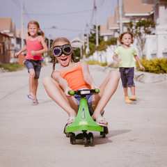 three happy children playing on the road at the day time