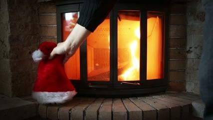 Placing a Santa hat near the fireplace