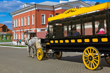 Horse-drawn carriages (omnibus) in Kolomna Kremlin - Russia - Mo