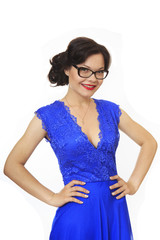 Beautiful girl with glasses and blue evening dress.