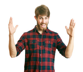 Happy young bearded man bragging about the big size of something
