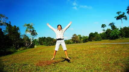 Happy woman jumping on the Prairie