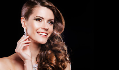 beautifyl young happy  brunette model with luxury accessories.
