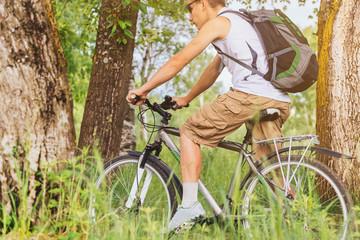 Man riding mountain bike in summer