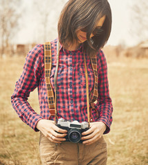 Tourist woman holding vintage photo camera