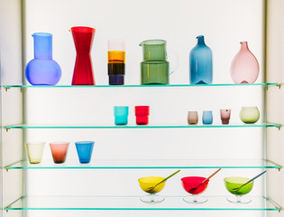 Assorted Different Sizes And Shapes Of Colorful Glassware On She