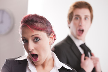 shocked business man and business woman