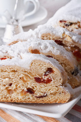 fruit cake German Stollen closeup on a plate. vertical