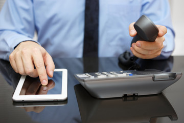 businessman is using tablet pc and calling support
