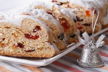 Tasty German Christmas fruit cake Stollen macro horizontal
