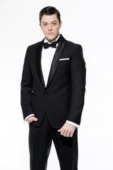 New year's eve fashion man wearing black dinner jacket. Isolated