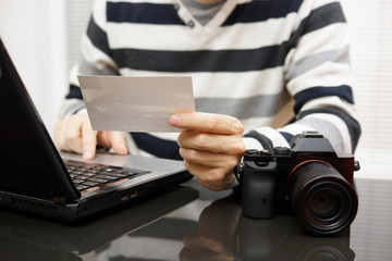 Photographer reviewing the image in the workplace