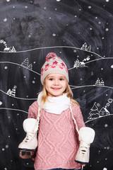 Little girl with skates on her neck