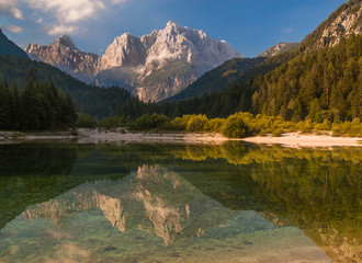 Mountain lake reflection in Alps