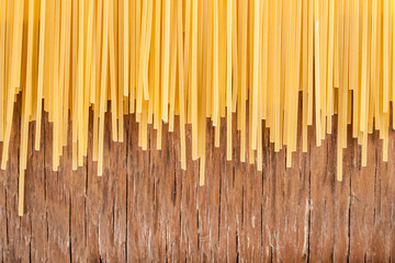 uncooked spaghetti posted on the a row