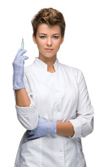 Portrait of lady surgeon showing syringe