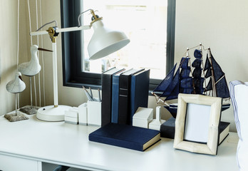work table with lamp,pencil, books in a home