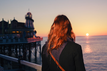 Woman admiring the sea at sunset