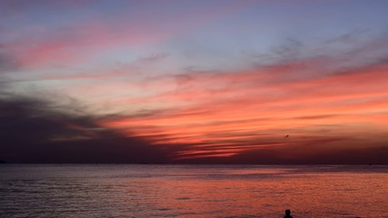 Time lapse of sunset with sea at Bangsean beach, Thailand