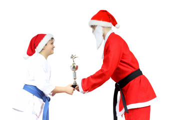 Santa Claus with  black belt gives athlete Sports Cup