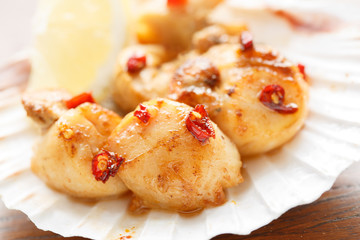 spicy fried scallops in a shell - shallow DOF