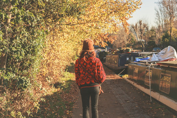 Woman walking by canal