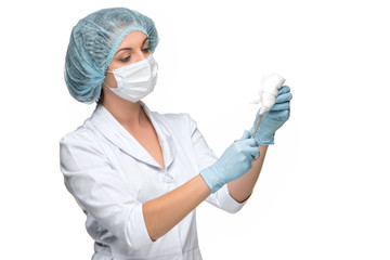 Portrait of lady surgeon holding surgical instrument over white