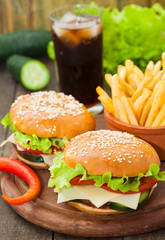 Burger with fries and cola, vertical
