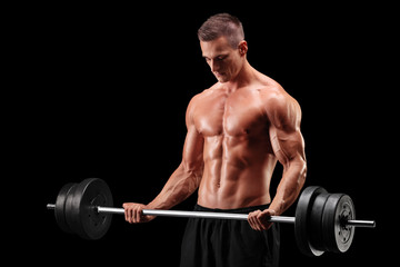 Shirtless athlete exercising with a barbell