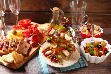 appetizers and antipasti on wooden table