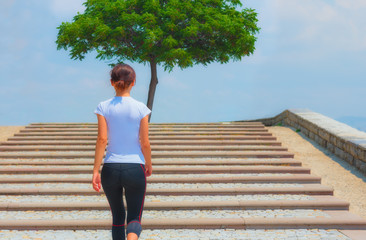 Runner girl - athlete running the stairs, woman fitness