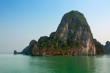 Halong Bay Vietnam with tourist boats and hazy blue sky