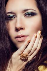 Close up model fashion portrait. Color smoky eyes turquoise.