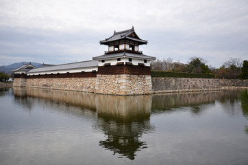 Entrance at Hiroshima castle with wall and water pond to protect