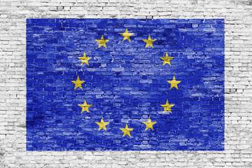 Flag of European Union over white brick wall