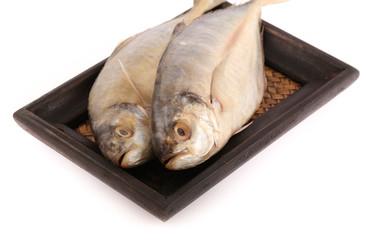 Fresh mackerel fishes on bamboo woven tray