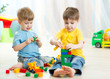 Kids playing toys in playroom at nursery